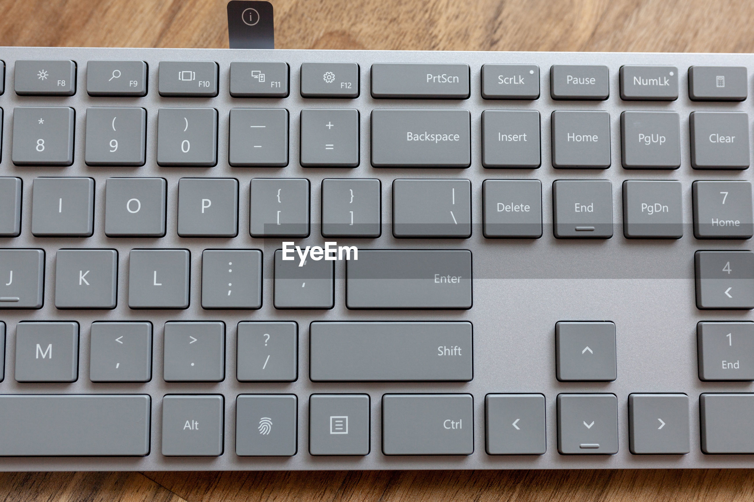 CLOSE-UP OF COMPUTER KEYBOARD ON TABLE AT HOME