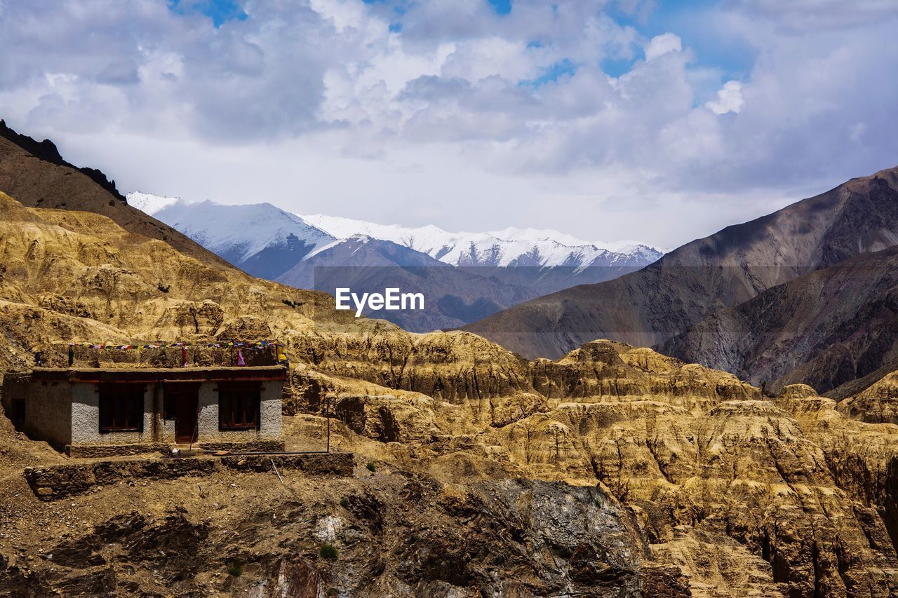 mountain, sky, tranquil scene, scenics, tranquility, nature, beauty in nature, day, no people, landscape, outdoors, built structure, mountain range, architecture