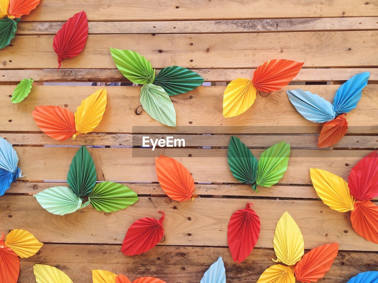 Close-Up Of Colorful Leaves On Wooden Surface