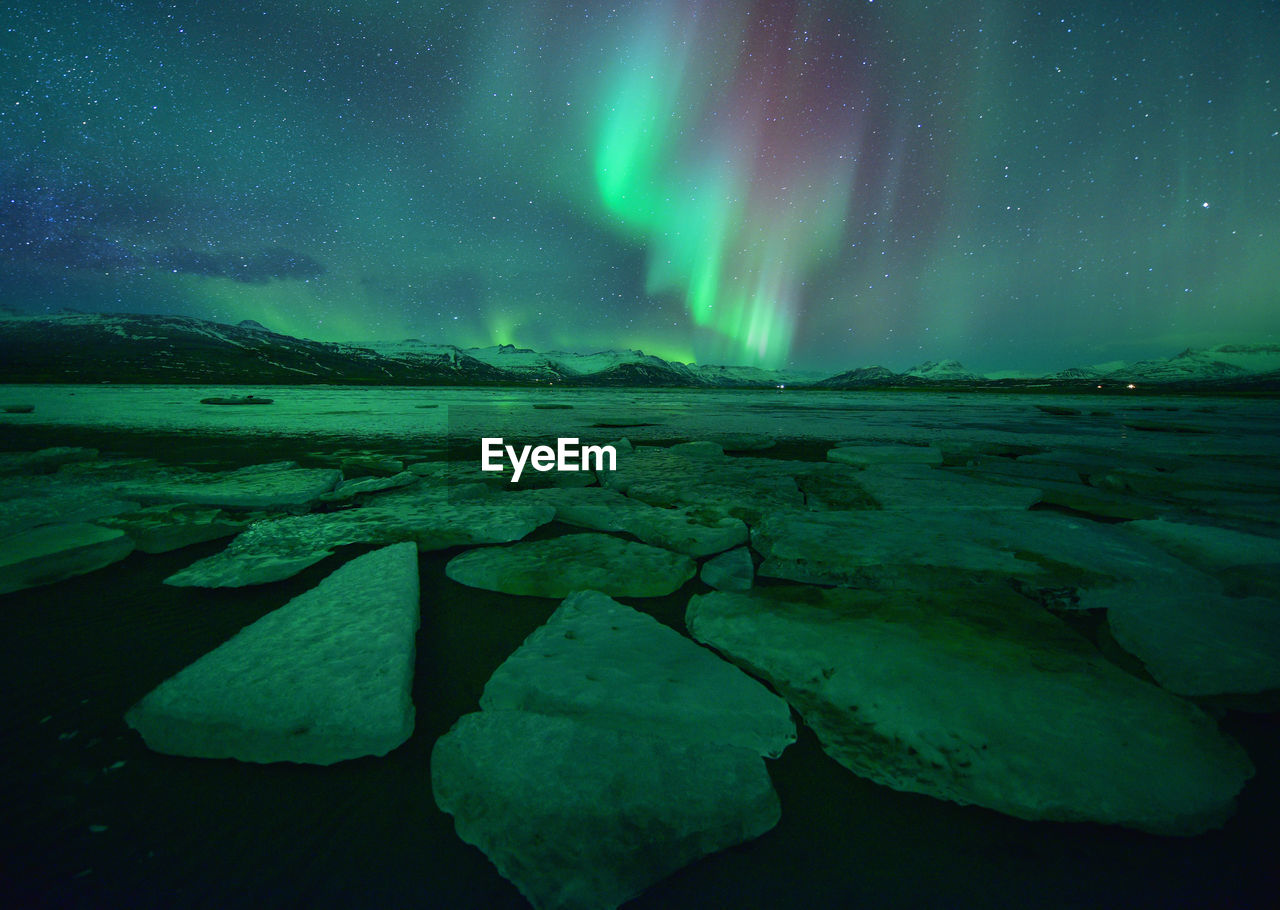 Beautiful aurora over famous diamond beach at night,night landscape, iceland