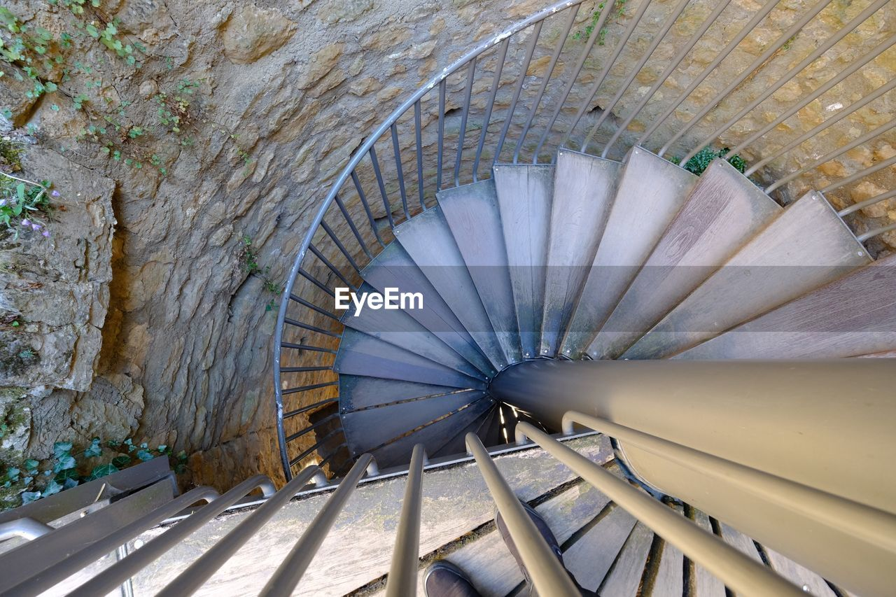 HIGH ANGLE VIEW OF SPIRAL STAIRCASE OF WALL