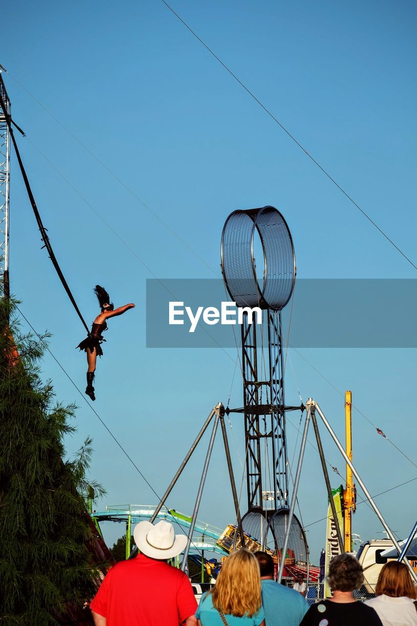 real people, men, day, leisure activity, lifestyles, outdoors, full length, cable, clear sky, sky, one person, tree, nature, people