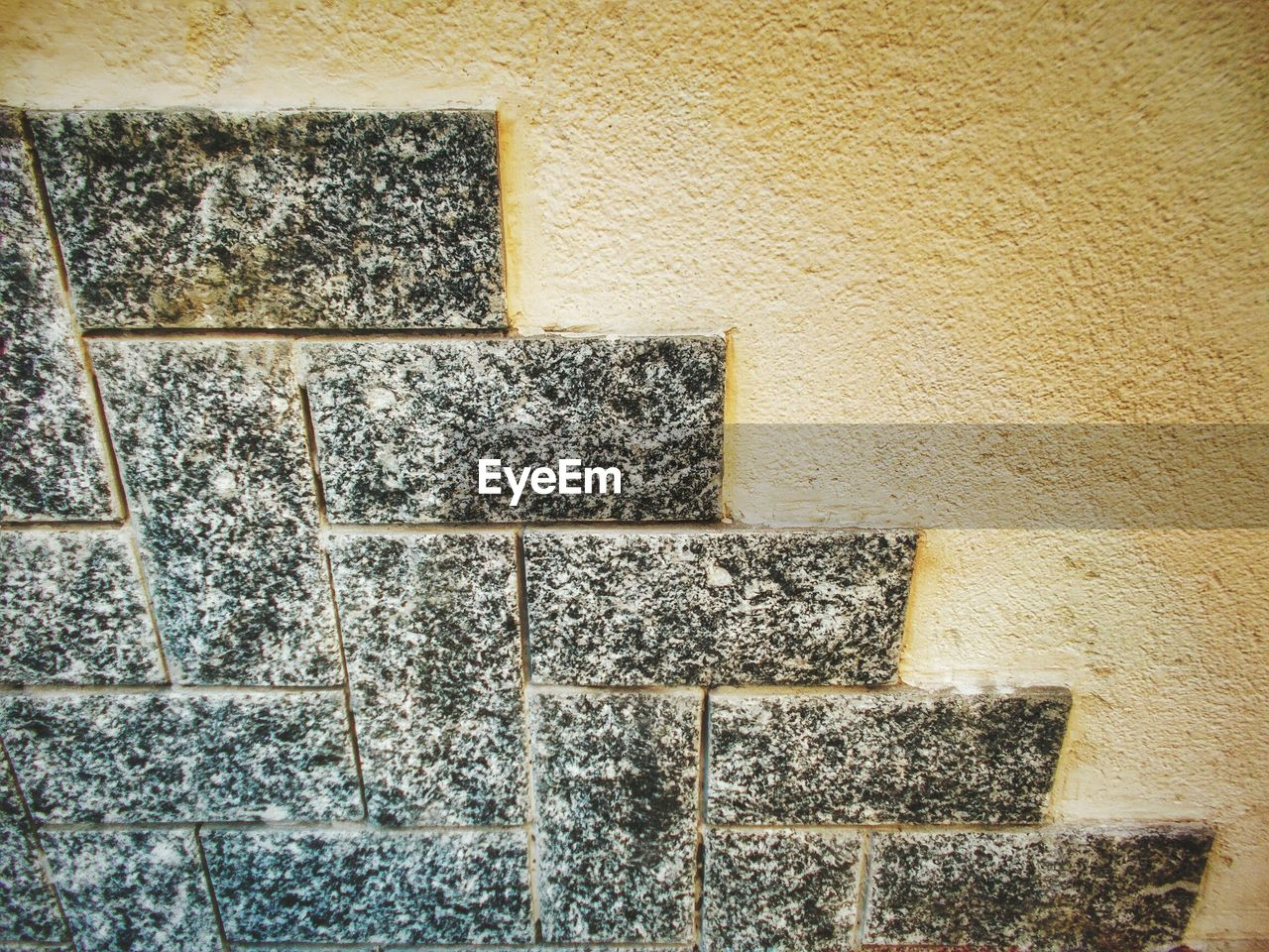 wall - building feature, built structure, stone material, textured, architecture, no people, day, indoors, building exterior, close-up
