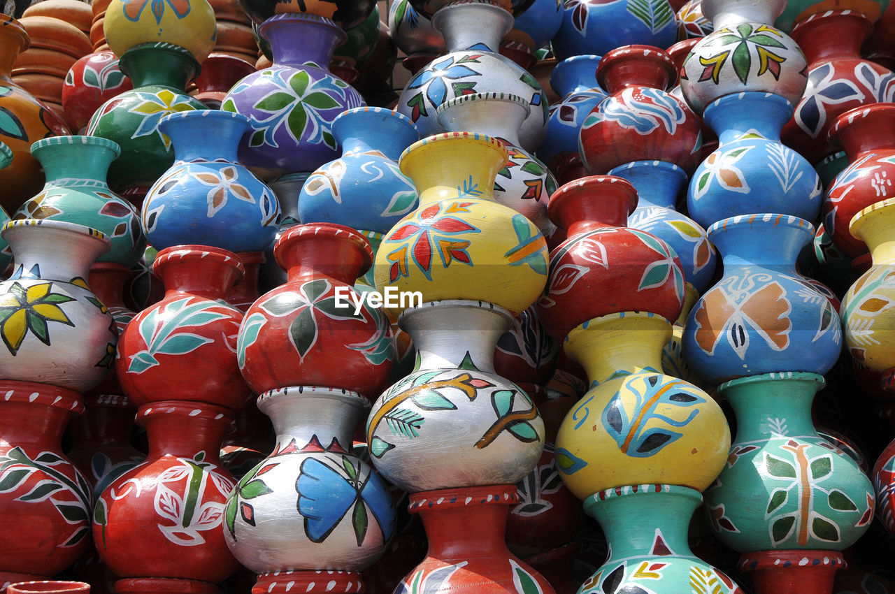 large group of objects, multi colored, full frame, no people, art and craft, creativity, backgrounds, choice, arrangement, abundance, variation, in a row, market, still life, retail, day, red, order, representation, close-up, outdoors, retail display, sale