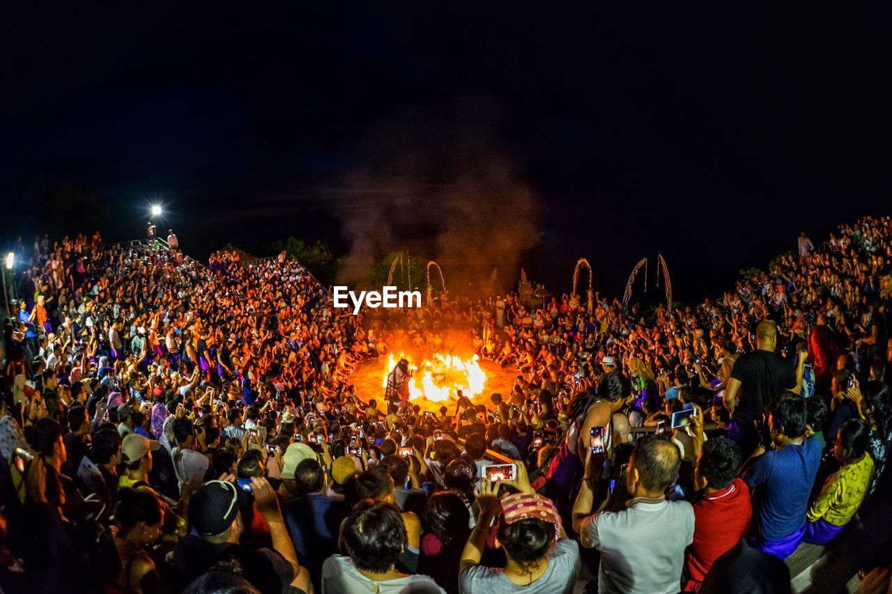 crowd, group of people, large group of people, real people, night, men, women, lifestyles, leisure activity, fire - natural phenomenon, burning, adult, fire, event, enjoyment, illuminated, outdoors, togetherness, nature, festival