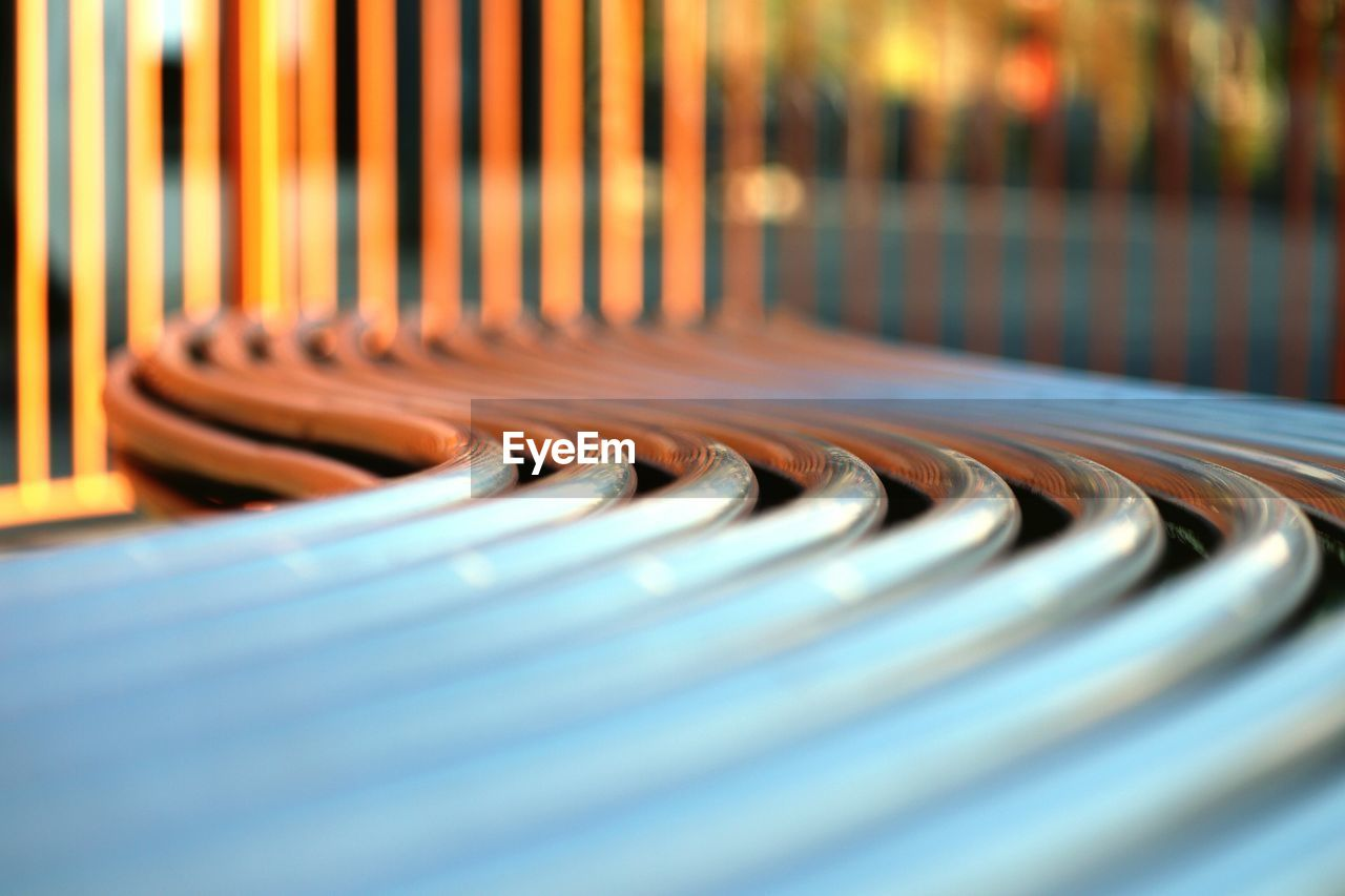 Close-up of curved metallic bench