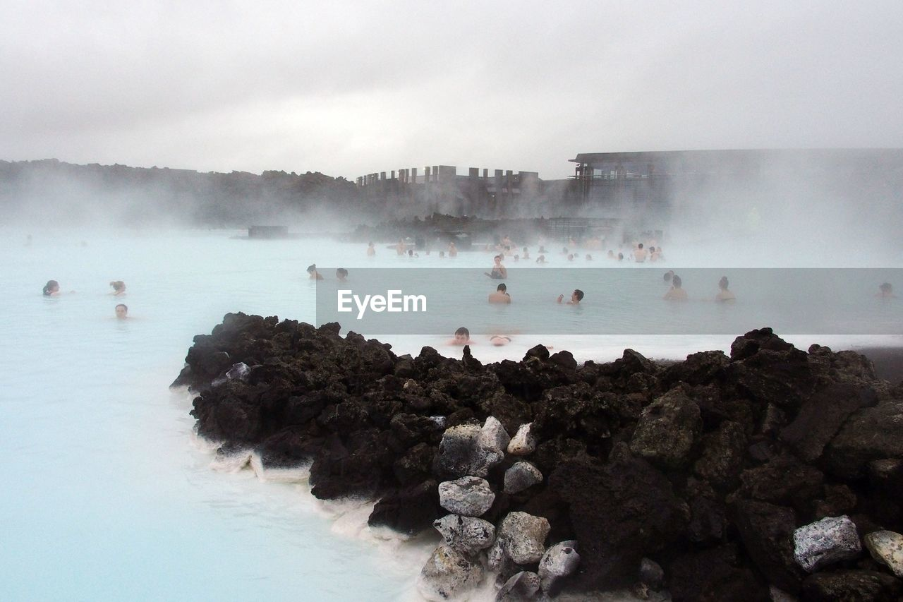 Group of people bathe in the blue lagoon