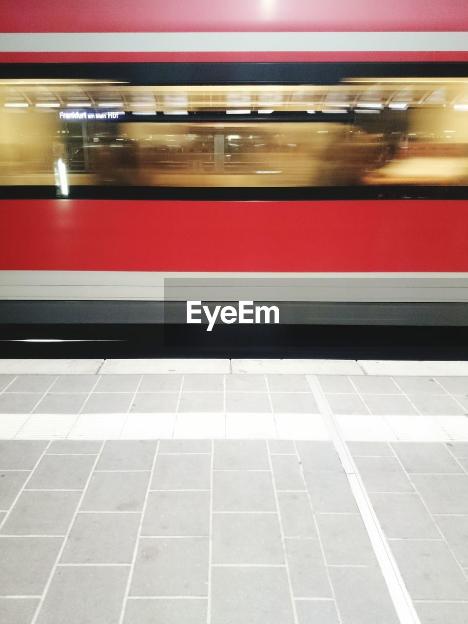 Blurred motion of train at railroad platform