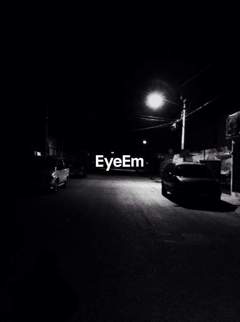 night, illuminated, transportation, land vehicle, car, mode of transport, street, road, street light, outdoors, no people, city, sky