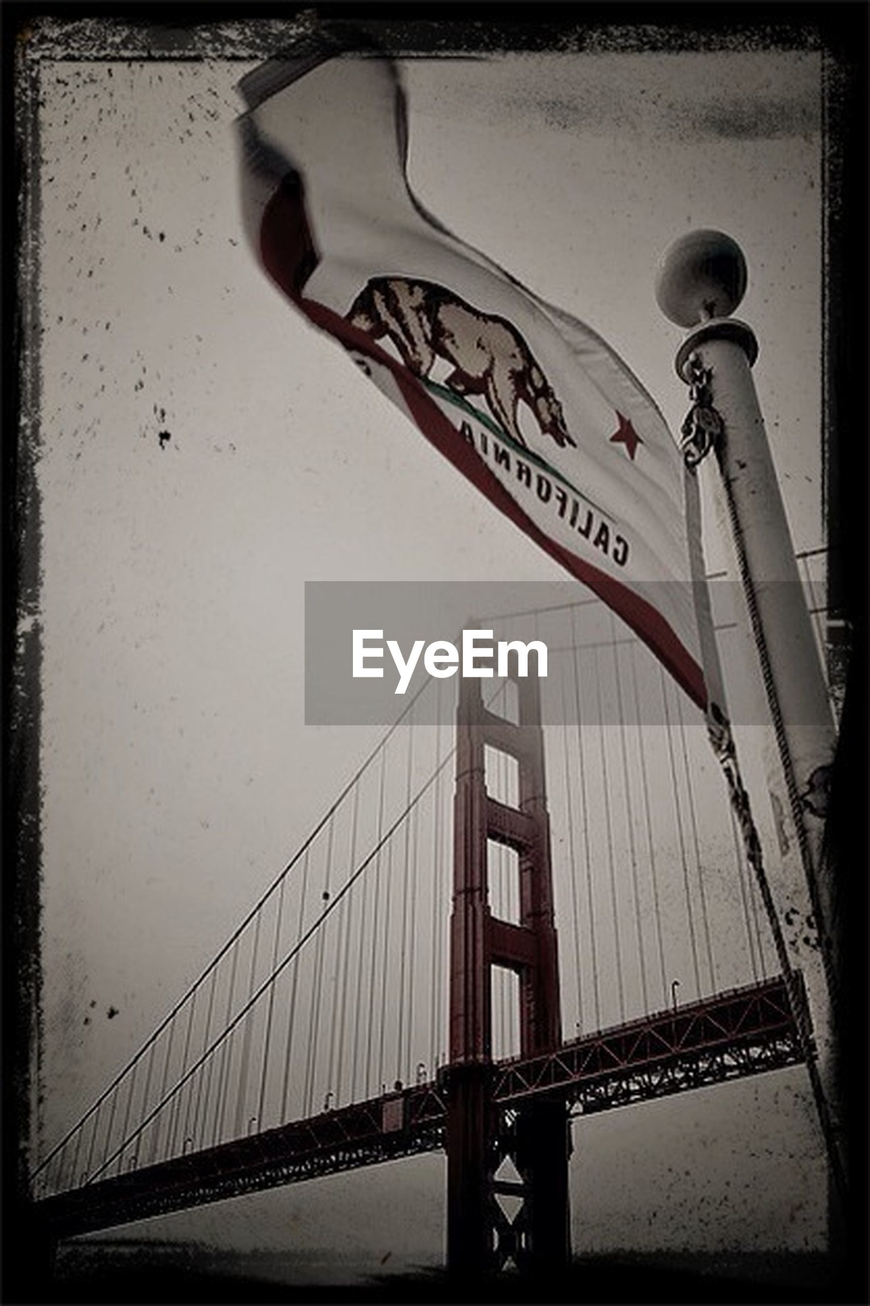 built structure, bridge - man made structure, railing, connection, architecture, transportation, transfer print, auto post production filter, bridge, low angle view, water, engineering, sky, bicycle, silhouette, day, men, sea