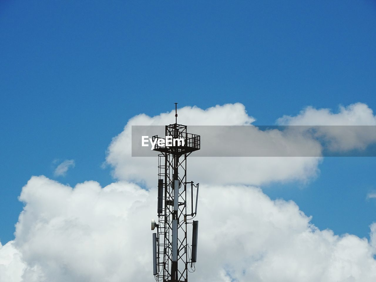 sky, cloud - sky, low angle view, technology, no people, day, connection, communication, nature, blue, outdoors, built structure, tower, antenna - aerial, architecture, wireless technology, electricity, metal, copy space, global communications, power supply, electrical equipment