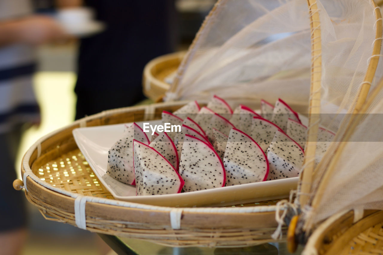 selective focus, basket, still life, close-up, incidental people, focus on foreground, food and drink, indoors, event, wedding, religion, celebration, freshness, food, table, container, belief