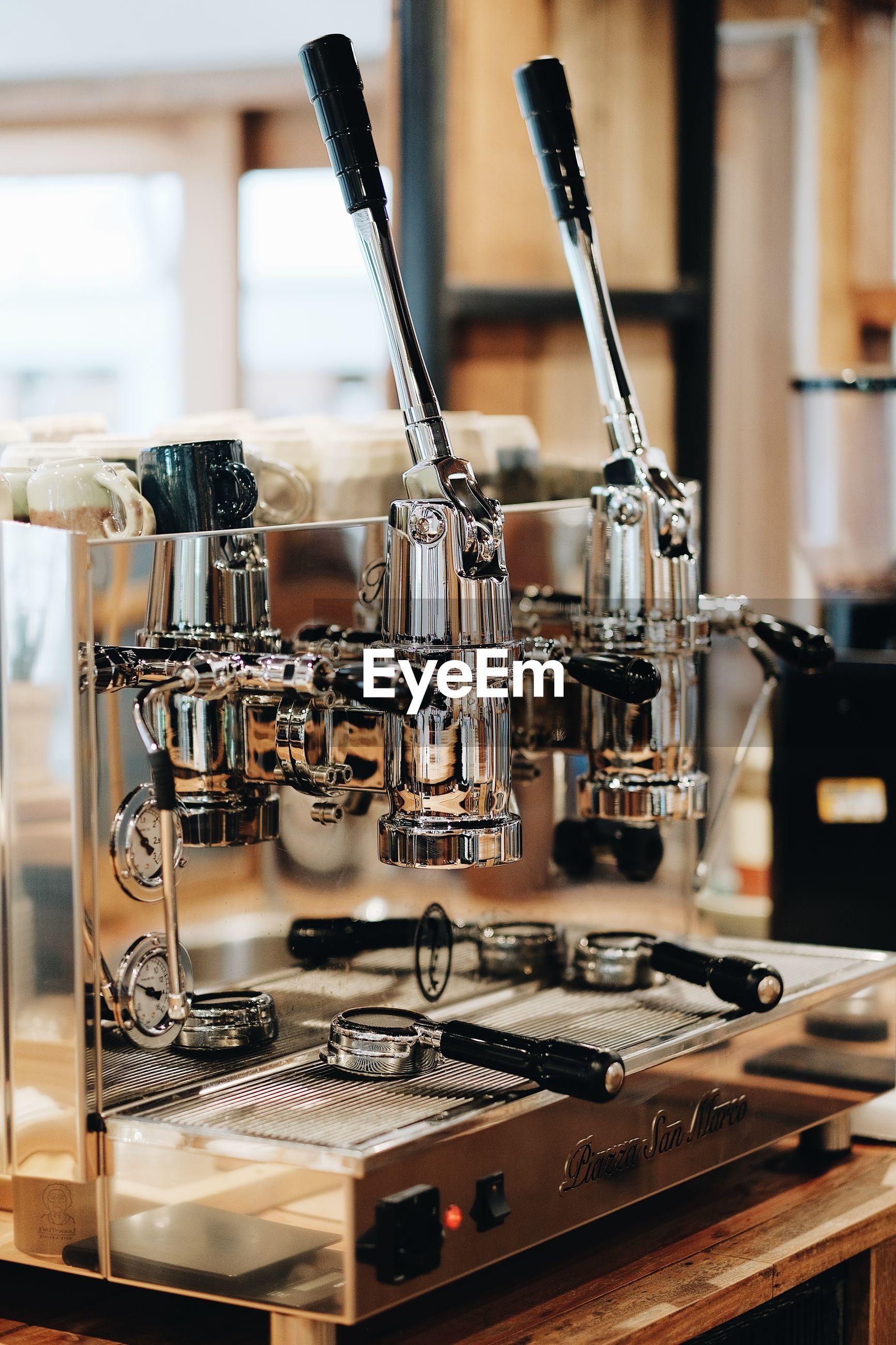 Close-up of espresso maker in cafe