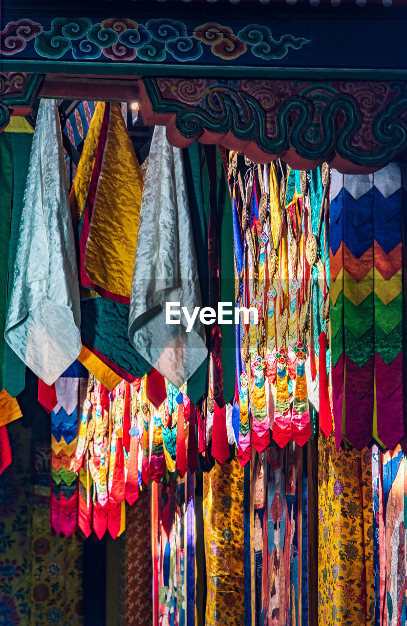 multi colored, hanging, choice, variation, for sale, market, retail, no people, large group of objects, textile, market stall, collection, abundance, art and craft, retail display, day, clothing, side by side, business, arrangement, sale, scarf, street market