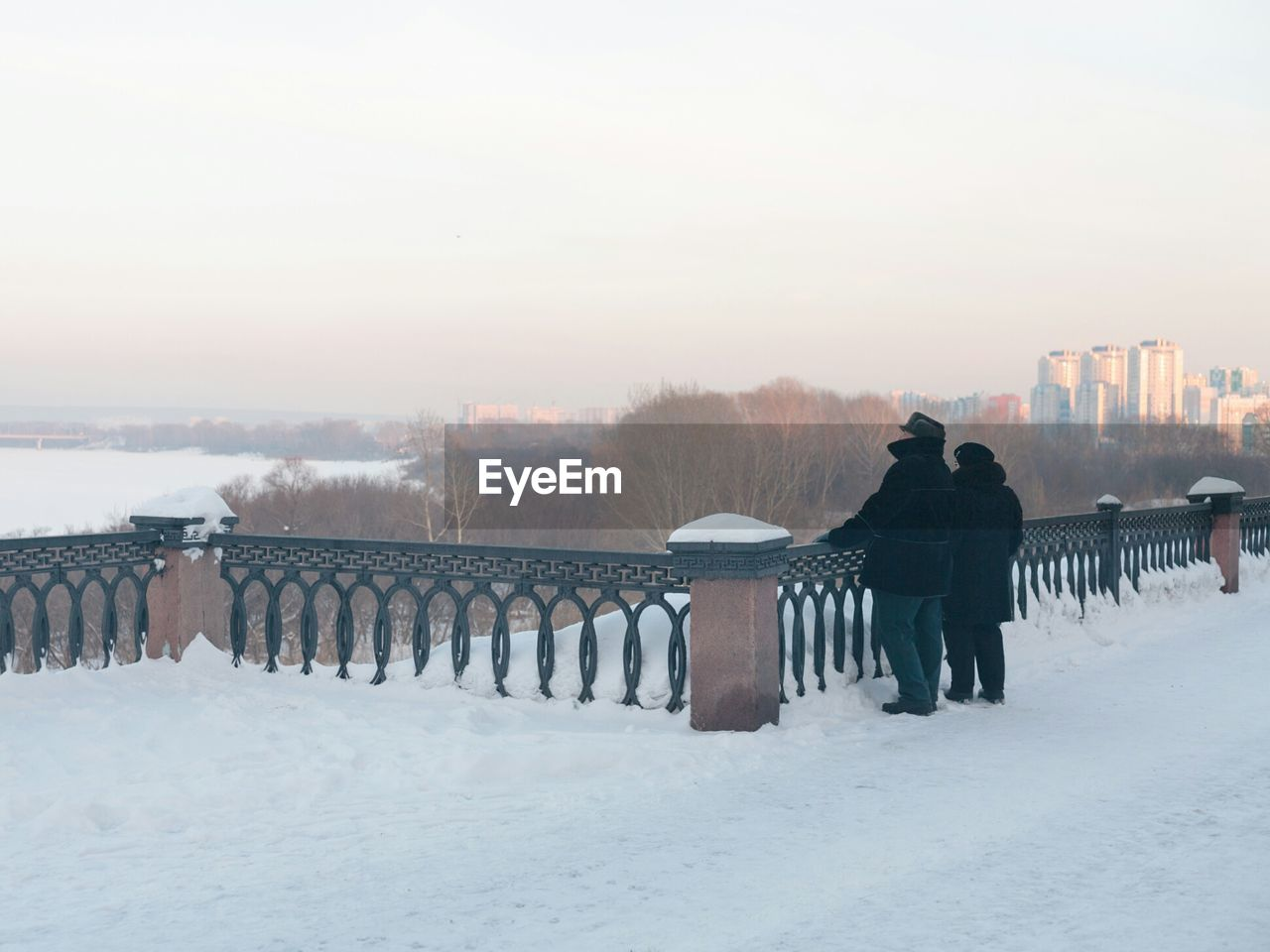 winter, cold temperature, snow, sky, nature, white color, warm clothing, railing, architecture, copy space, real people, men, lifestyles, covering, fence, barrier, field, scenics - nature, built structure, outdoors