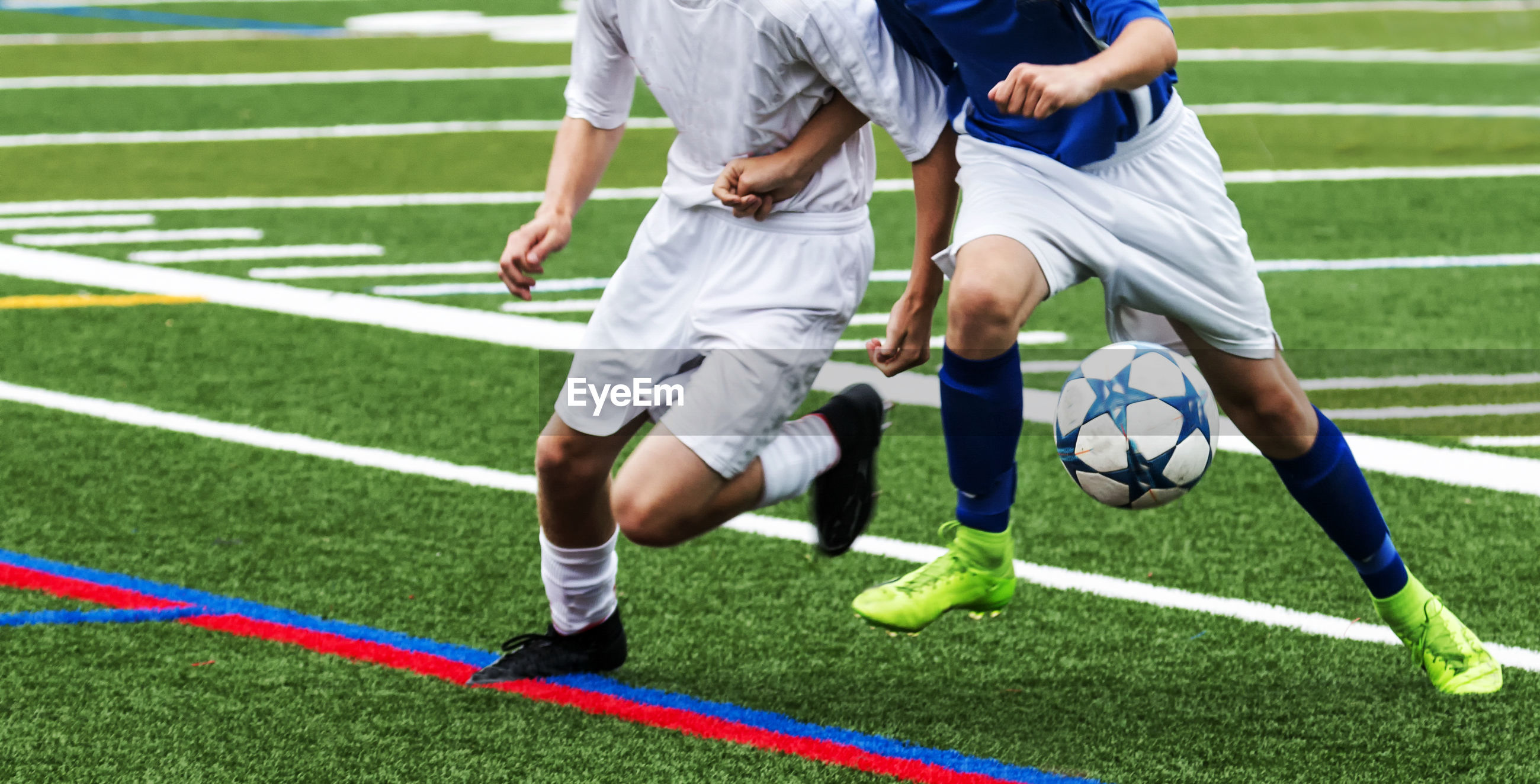 Low section of players playing soccer