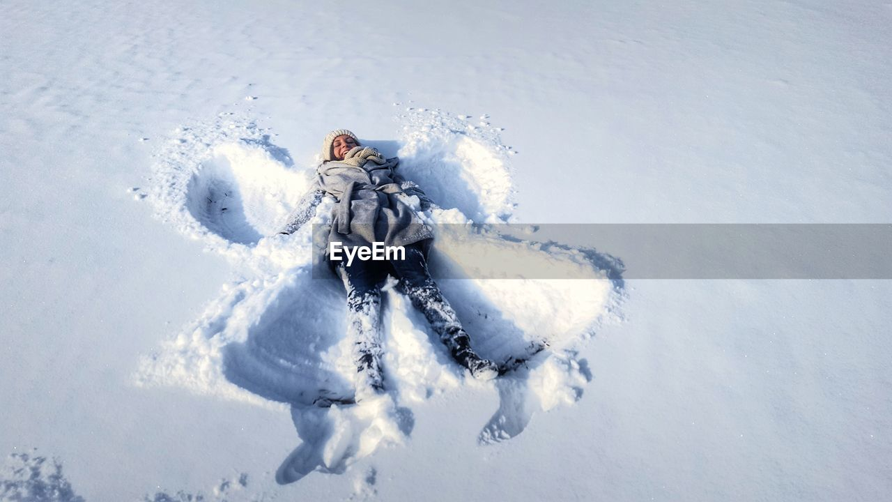 High Angle View Of Person Making Snow Angel