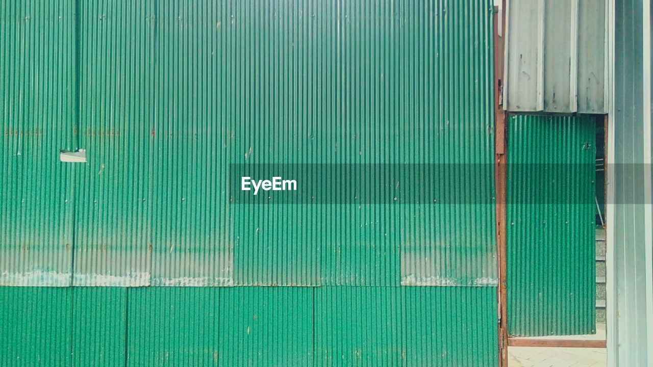 green color, architecture, built structure, wood - material, no people, wall - building feature, full frame, backgrounds, day, building exterior, pattern, old, entrance, door, textured, outdoors, metal, security, safety, close-up, turquoise colored, corrugated