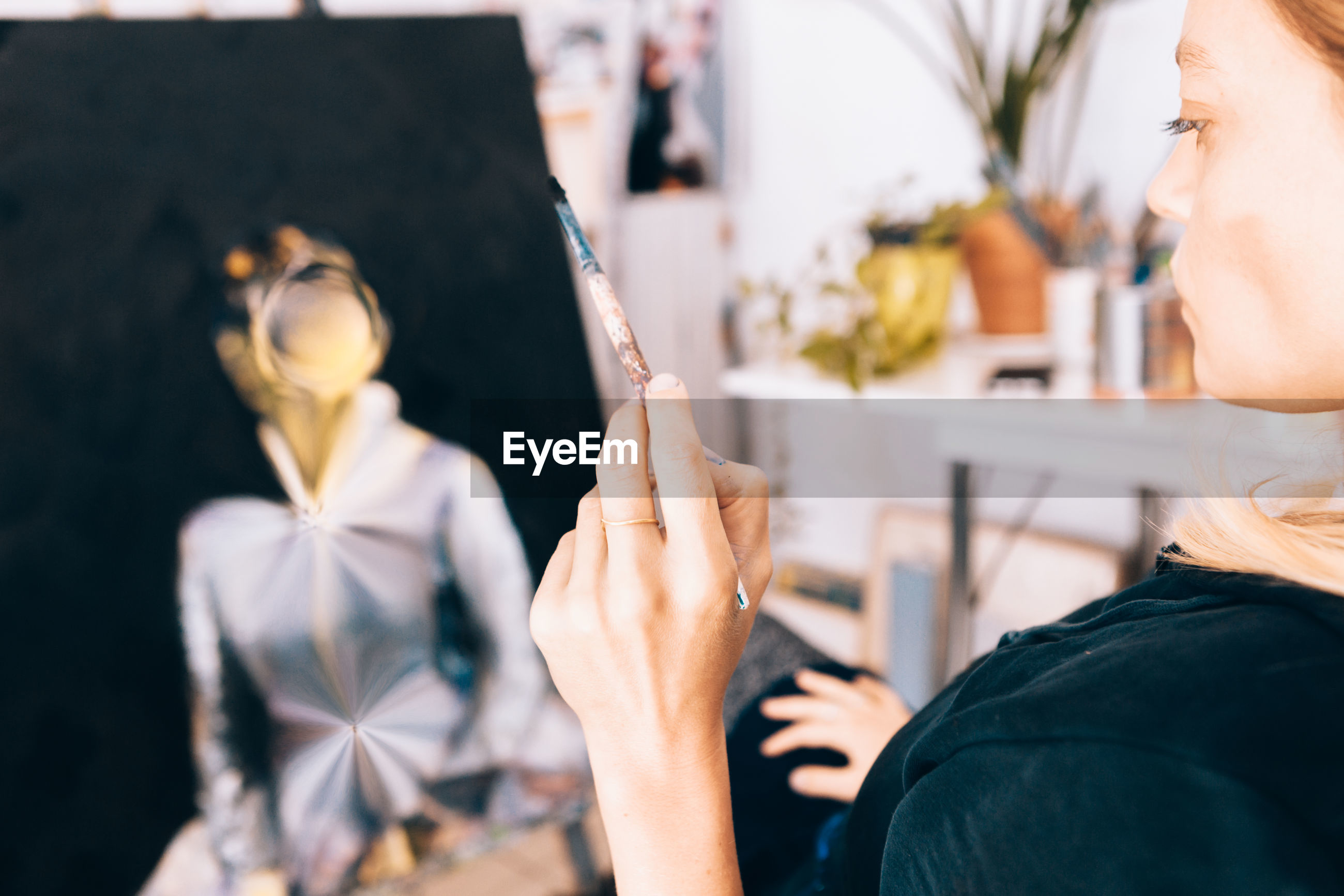 Woman painting at studio