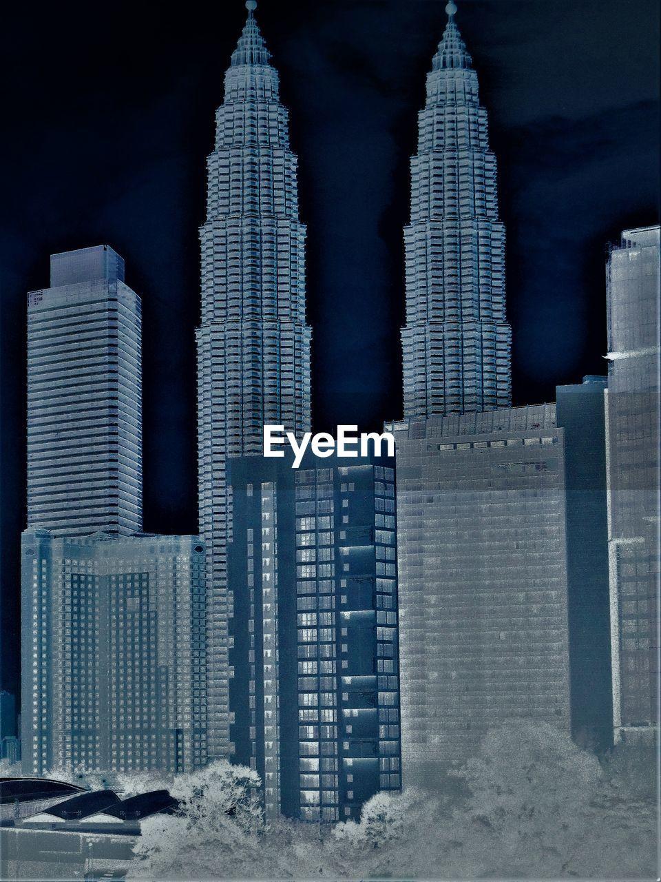 skyscraper, architecture, building exterior, built structure, city, tall - high, tower, modern, cityscape, financial district, urban skyline, travel destinations, downtown district, illuminated, no people, outdoors, night, sky