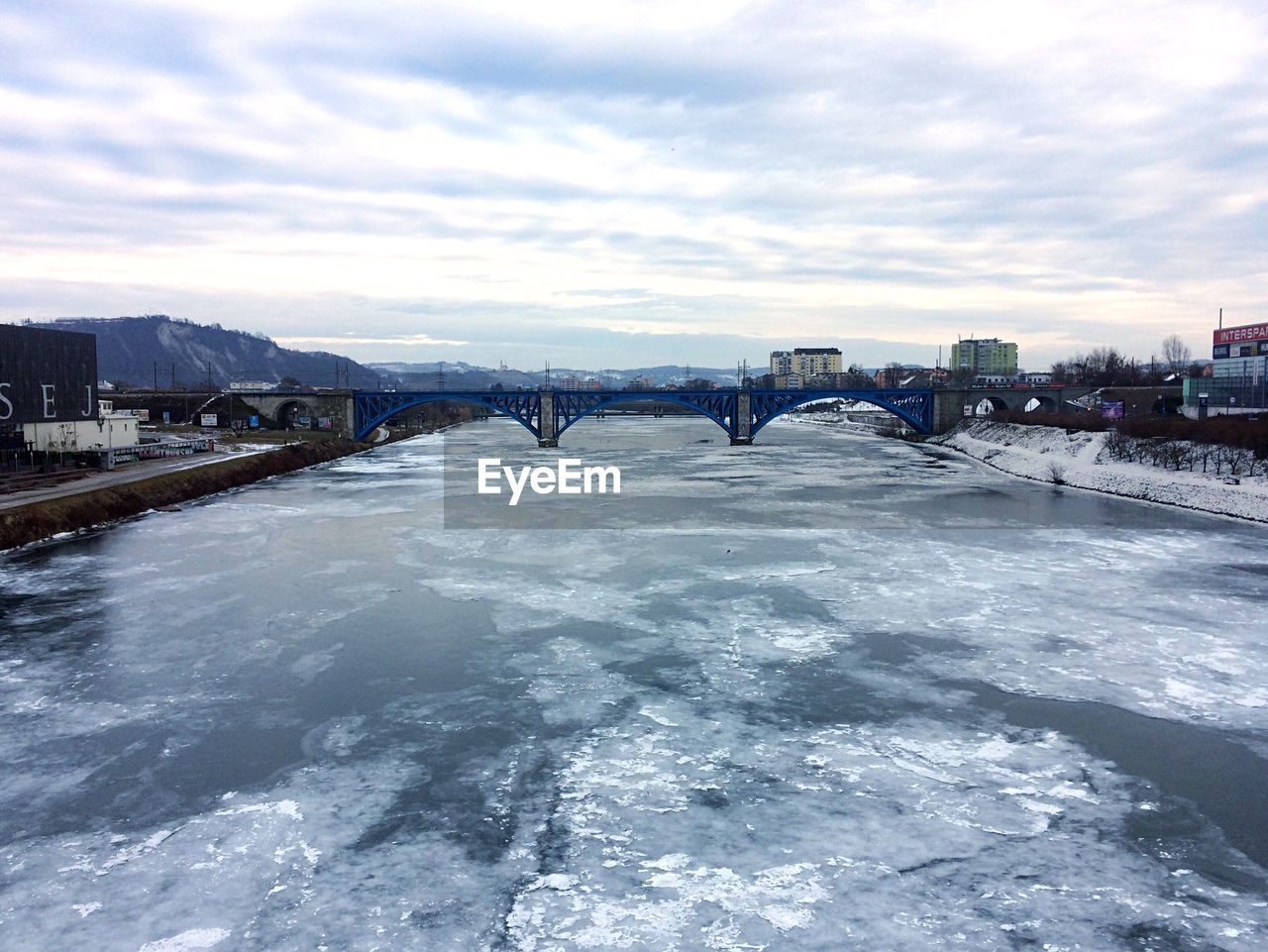 bridge - man made structure, connection, sky, winter, architecture, built structure, river, cloud - sky, cold temperature, weather, snow, water, outdoors, ice, transportation, city, day, bridge, waterfront, no people, nature, cityscape, scenics, building exterior