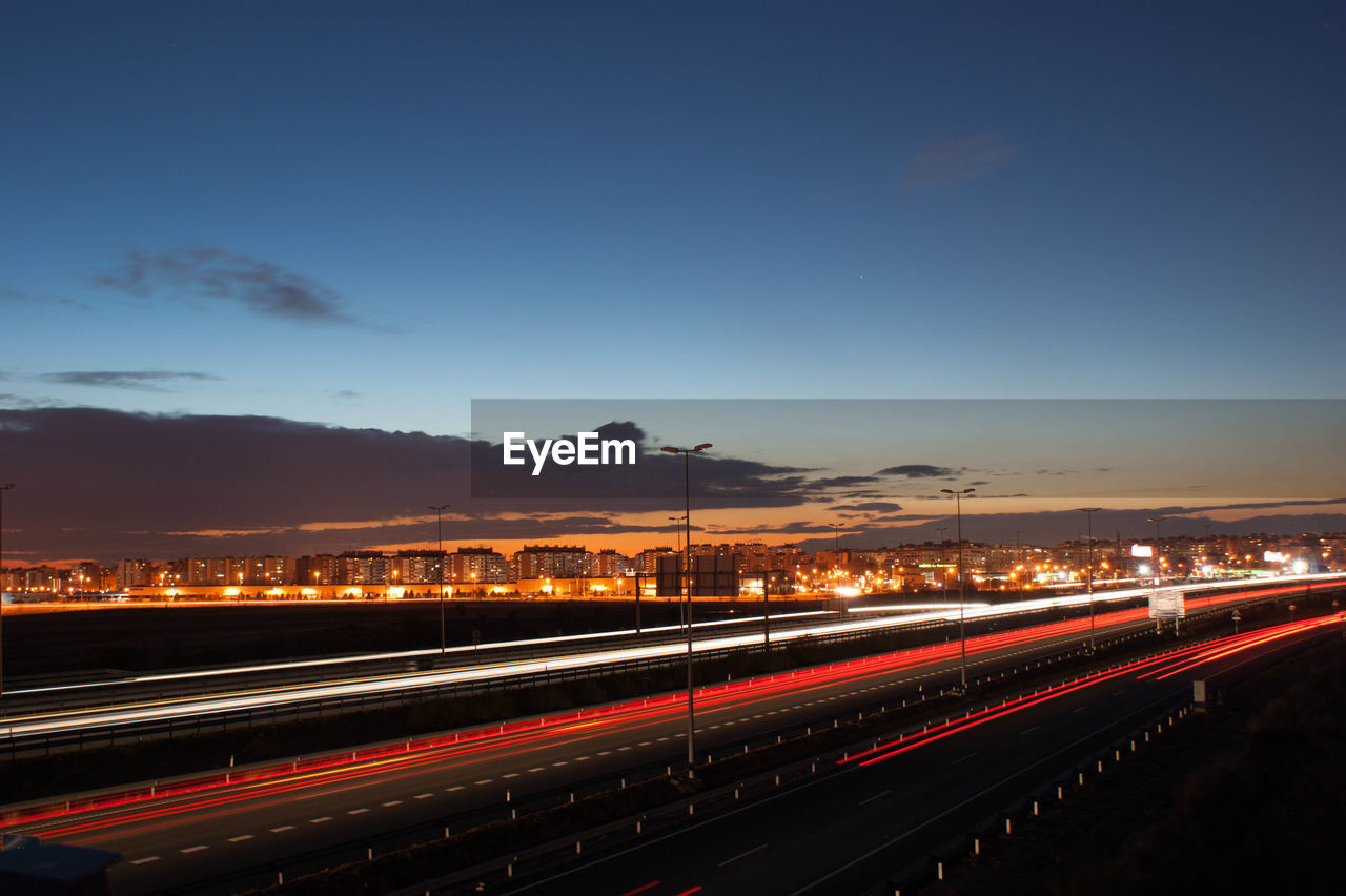 illuminated, light trail, sky, speed, long exposure, motion, transportation, city, night, road, no people, nature, street, architecture, high angle view, blurred motion, city life, outdoors, highway, traffic, multiple lane highway