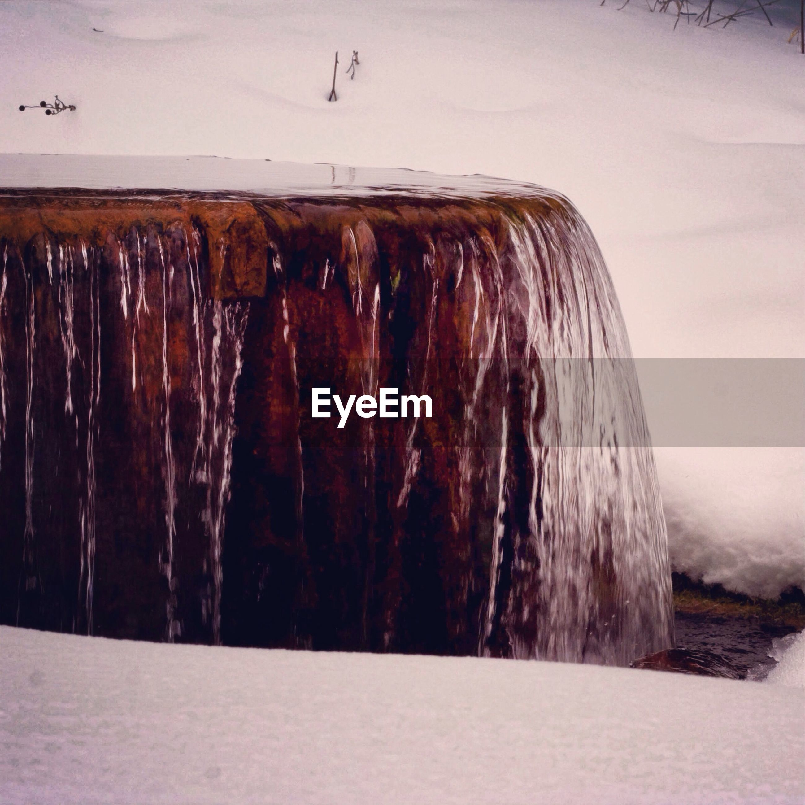 Close-up of waterfall in snow field