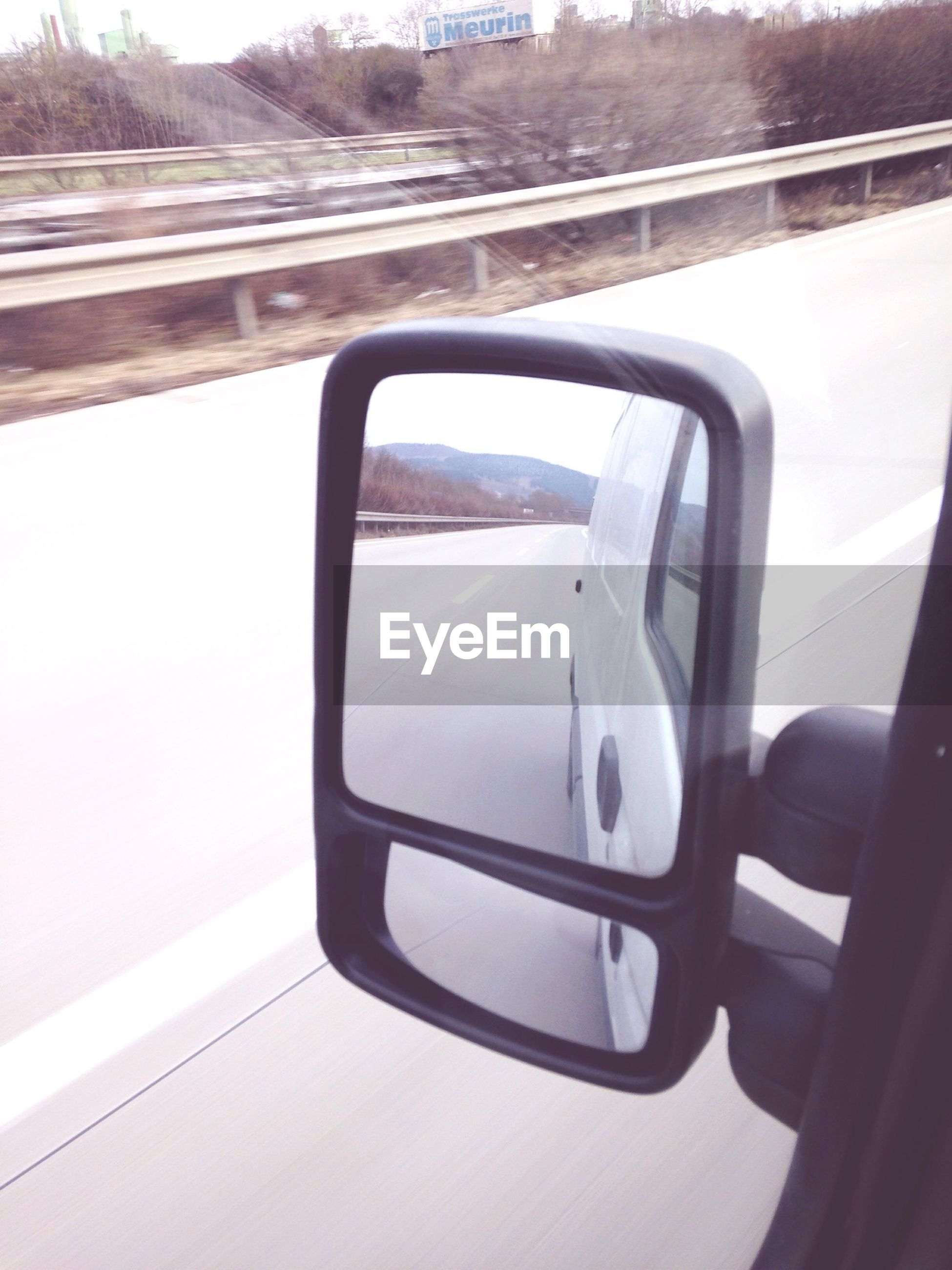 transportation, mode of transport, land vehicle, vehicle interior, car, travel, side-view mirror, public transportation, reflection, glass - material, car interior, journey, transparent, train - vehicle, on the move, window, part of, windshield, one person, road
