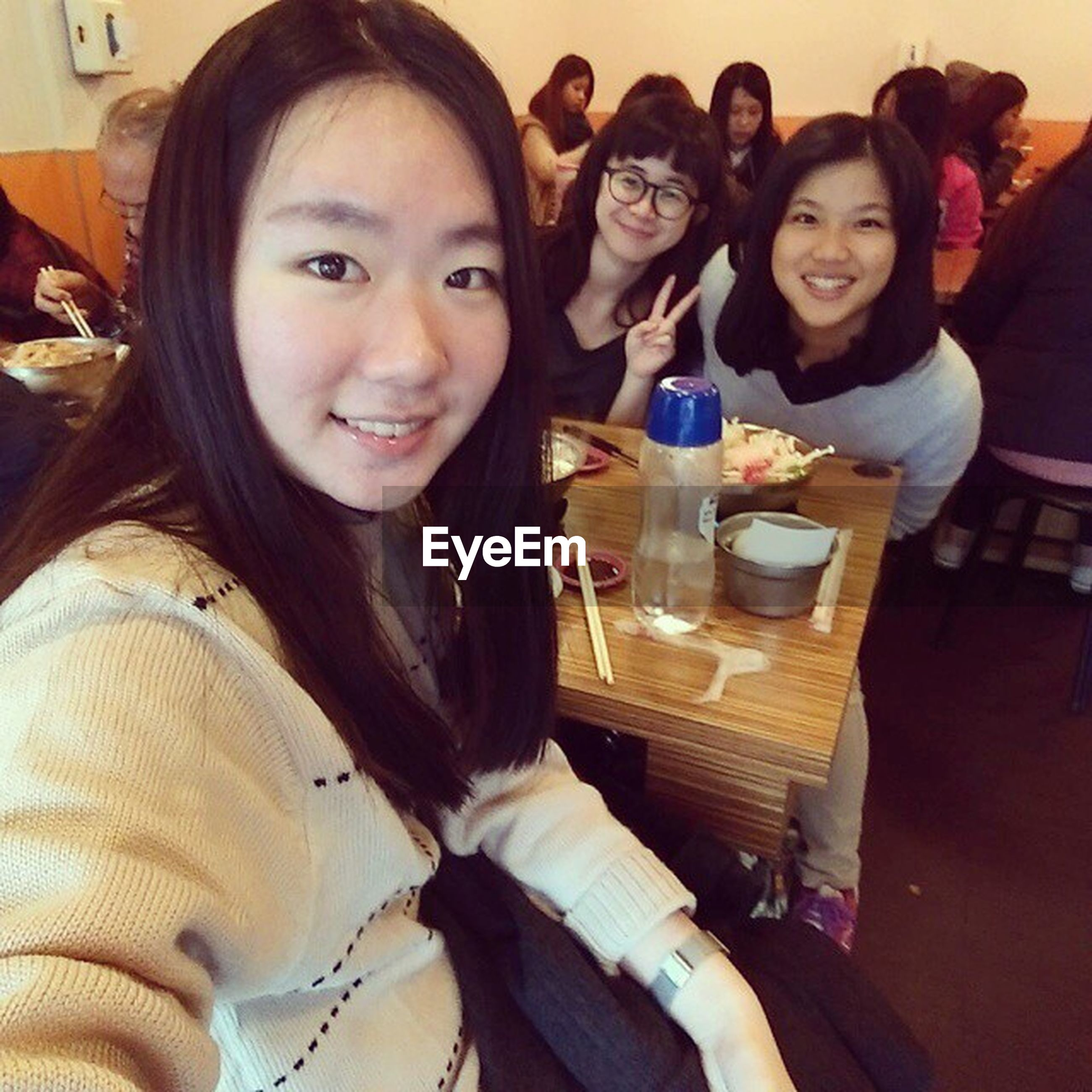 indoors, person, lifestyles, young adult, young women, casual clothing, leisure activity, togetherness, portrait, looking at camera, smiling, front view, happiness, sitting, bonding, restaurant, table