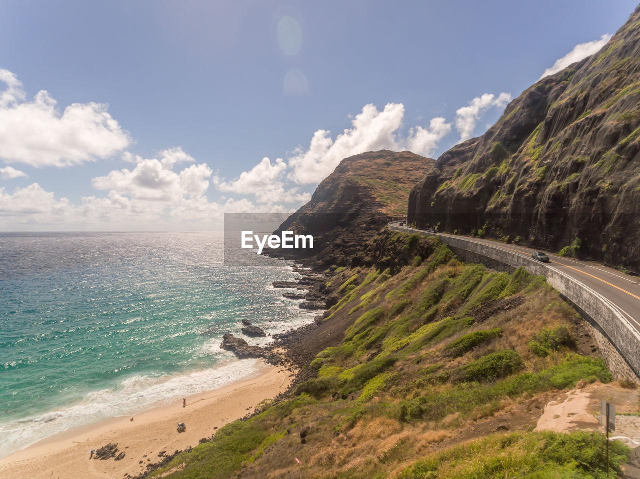 sky, sea, water, beach, cloud - sky, land, scenics - nature, beauty in nature, tranquil scene, nature, tranquility, mountain, day, horizon, no people, horizon over water, motion, coastline, road, outdoors