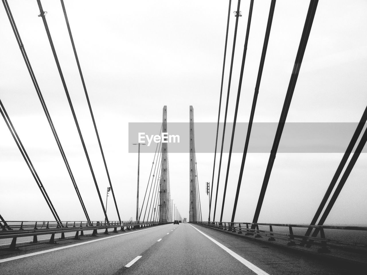 Cables and towers of bridge against sky