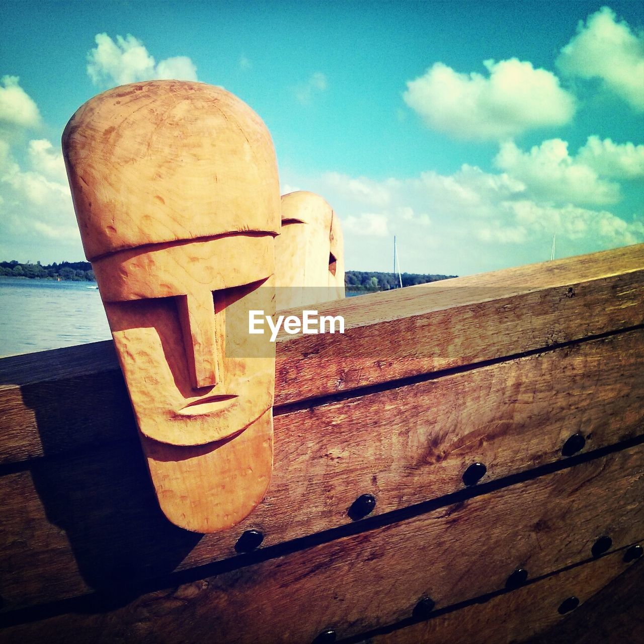 Close-up of wooden faces on ship