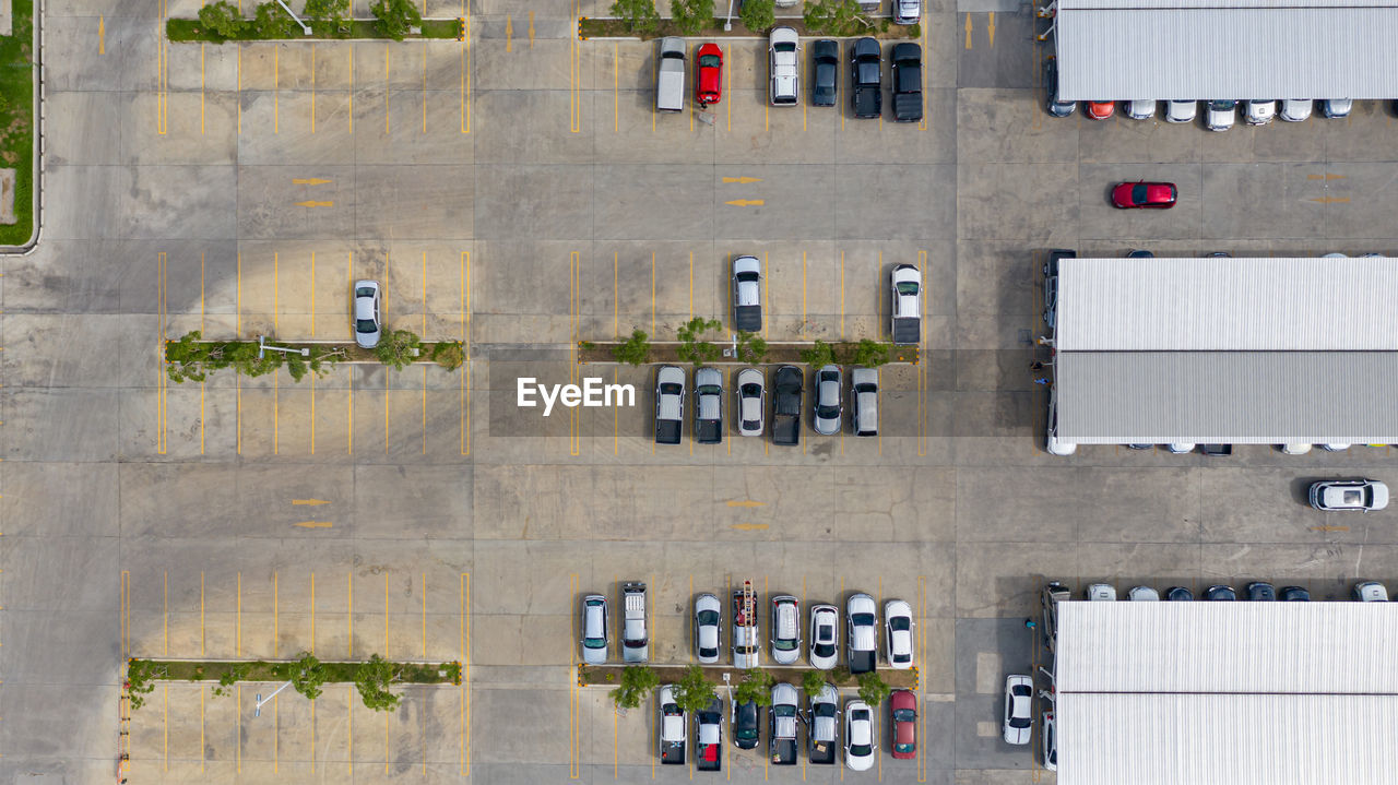 HIGH ANGLE VIEW OF CARS AND BUILDING