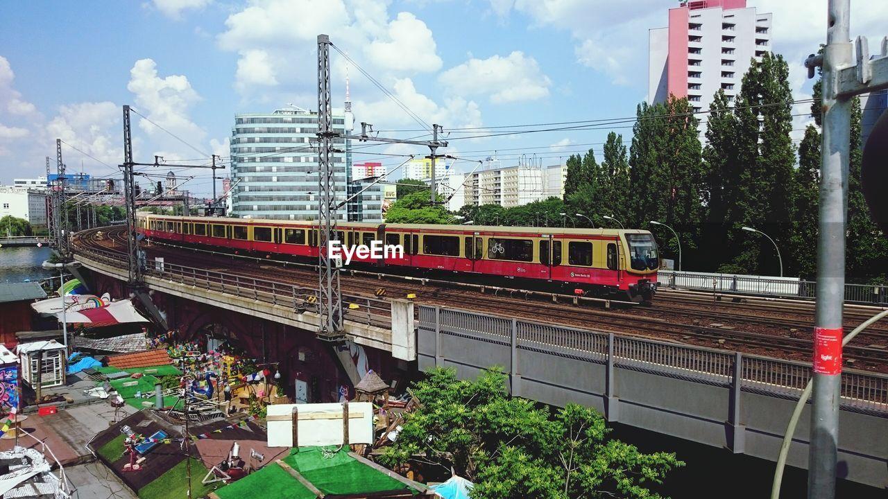 Train On Bridge Against Built Structures