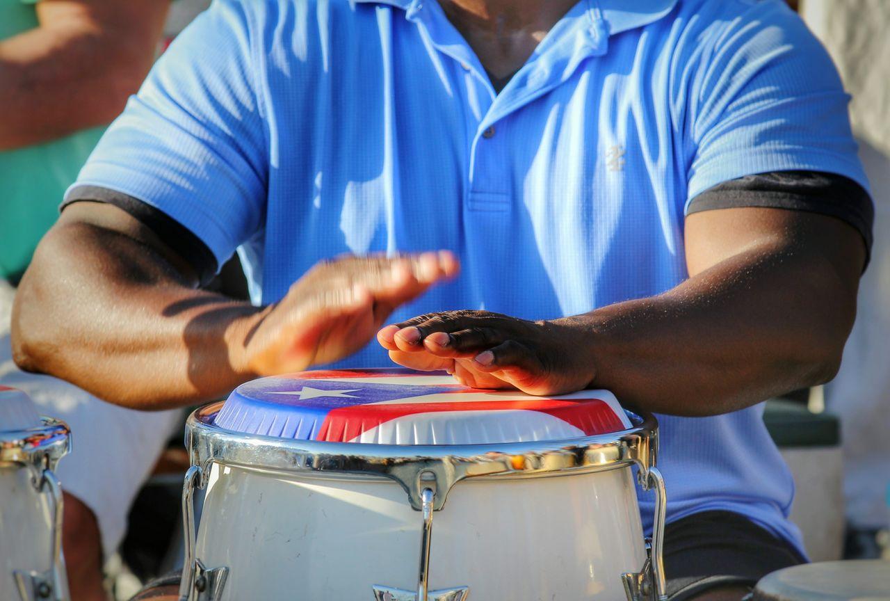 Cropped Image Of Man Playing Bongo