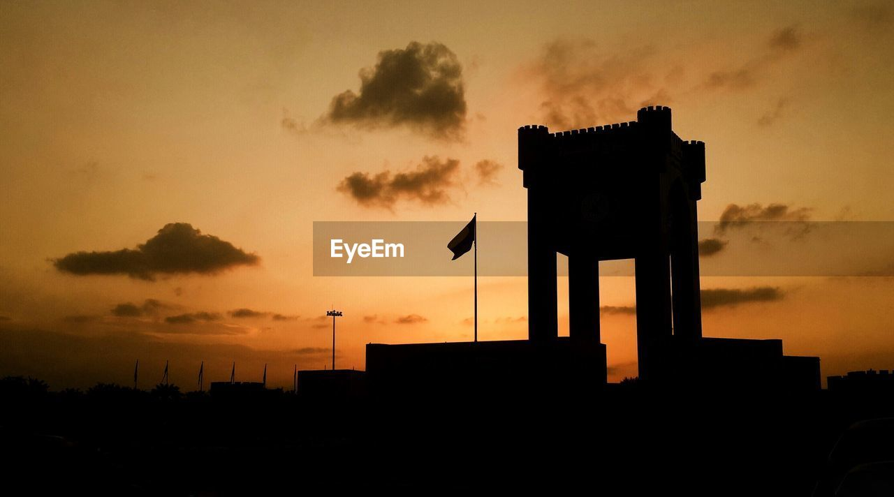 sunset, sky, silhouette, built structure, architecture, cloud - sky, orange color, building exterior, nature, no people, low angle view, beauty in nature, outdoors, city, dramatic sky, sun, tree, building, dusk, street