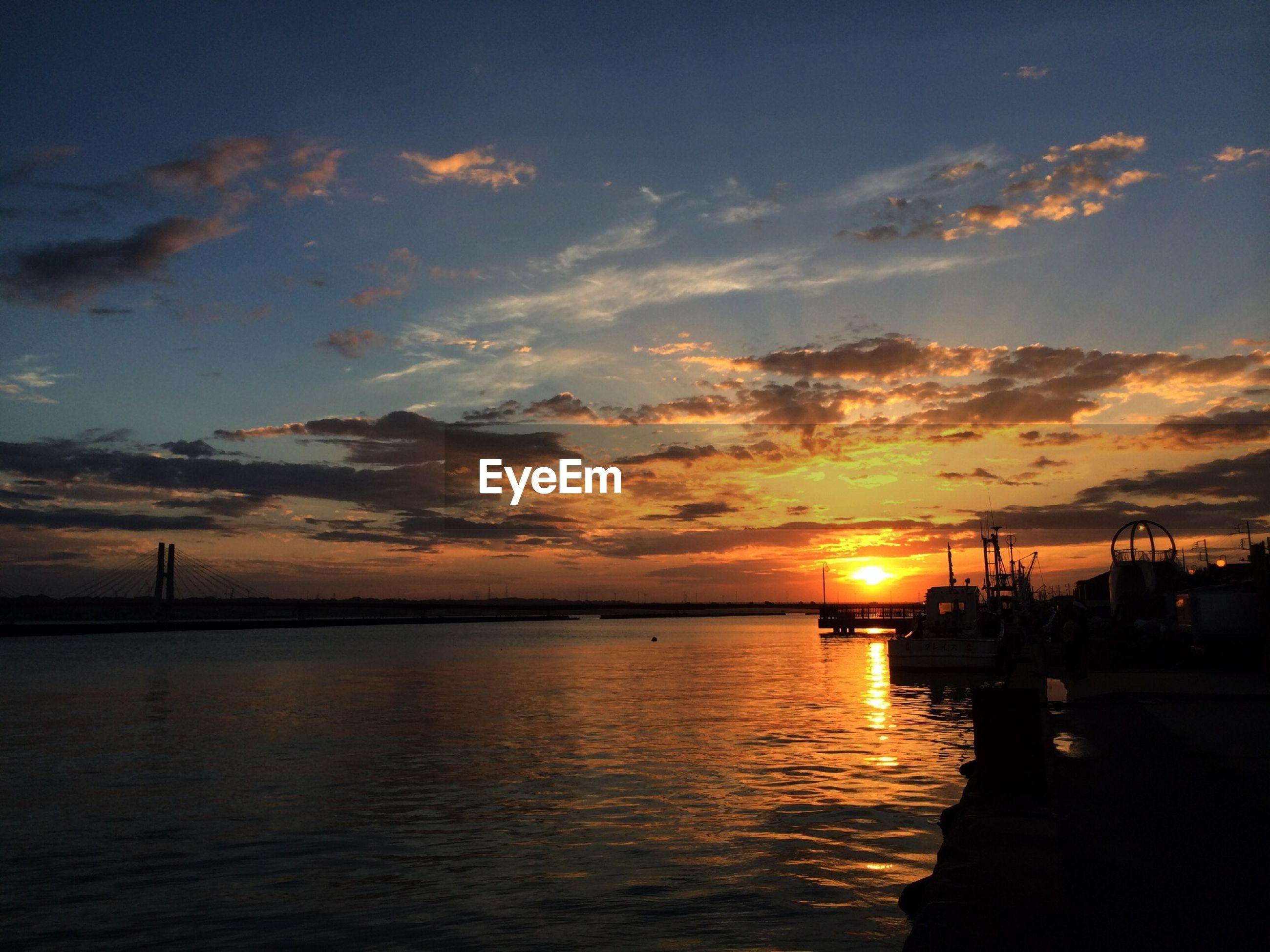 sunset, water, silhouette, sea, sky, sun, scenics, orange color, beauty in nature, tranquil scene, tranquility, cloud - sky, waterfront, nautical vessel, idyllic, nature, transportation, reflection, sunlight, cloud