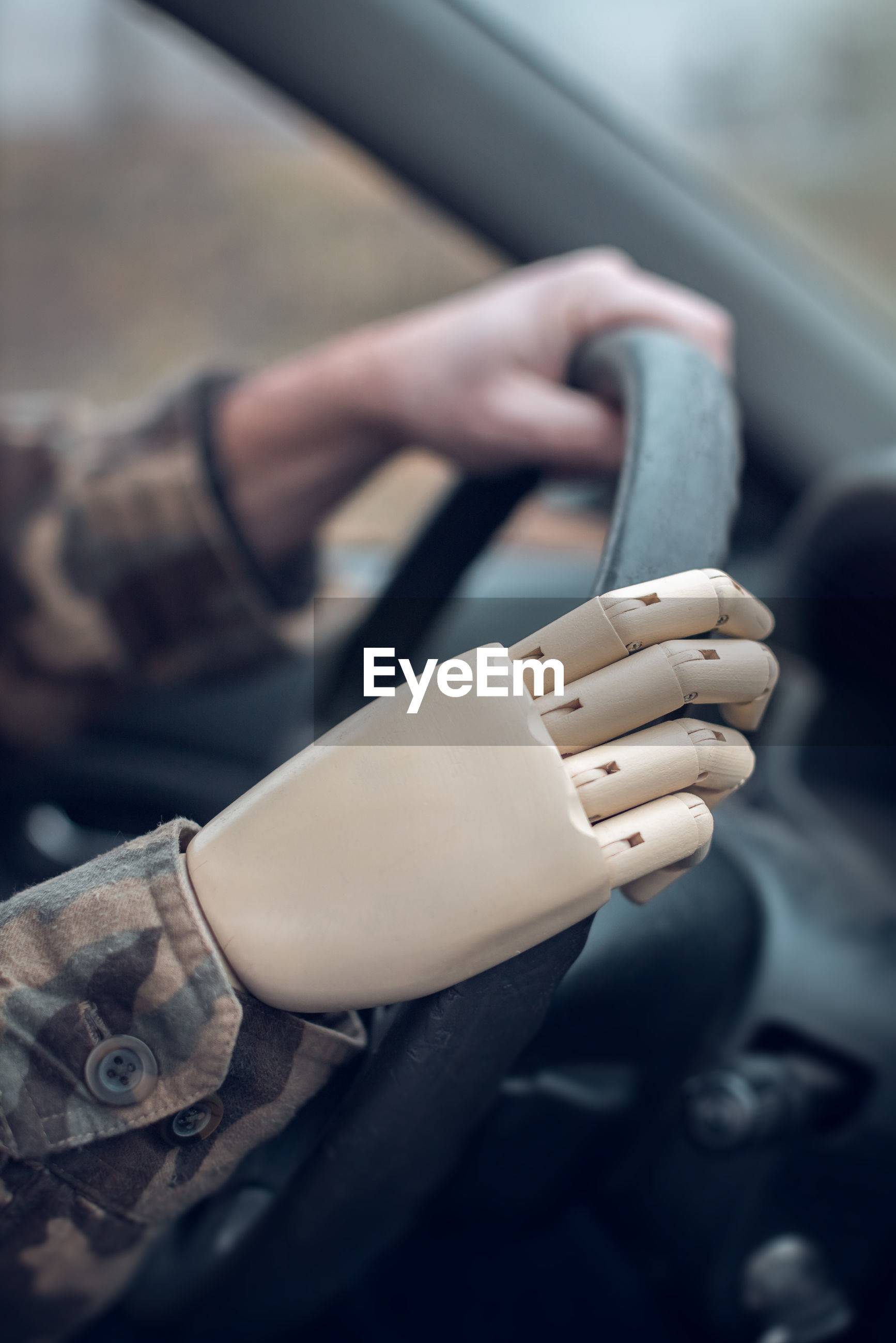 Soldier with artificial hand driving car