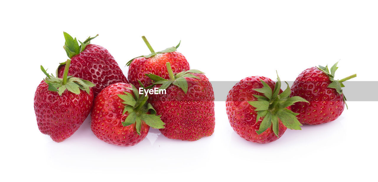 white background, fruit, red, studio shot, healthy eating, berry fruit, food and drink, strawberry, freshness, food, still life, indoors, wellbeing, close-up, group of objects, no people, cut out, copy space, leaf, plant part, ripe