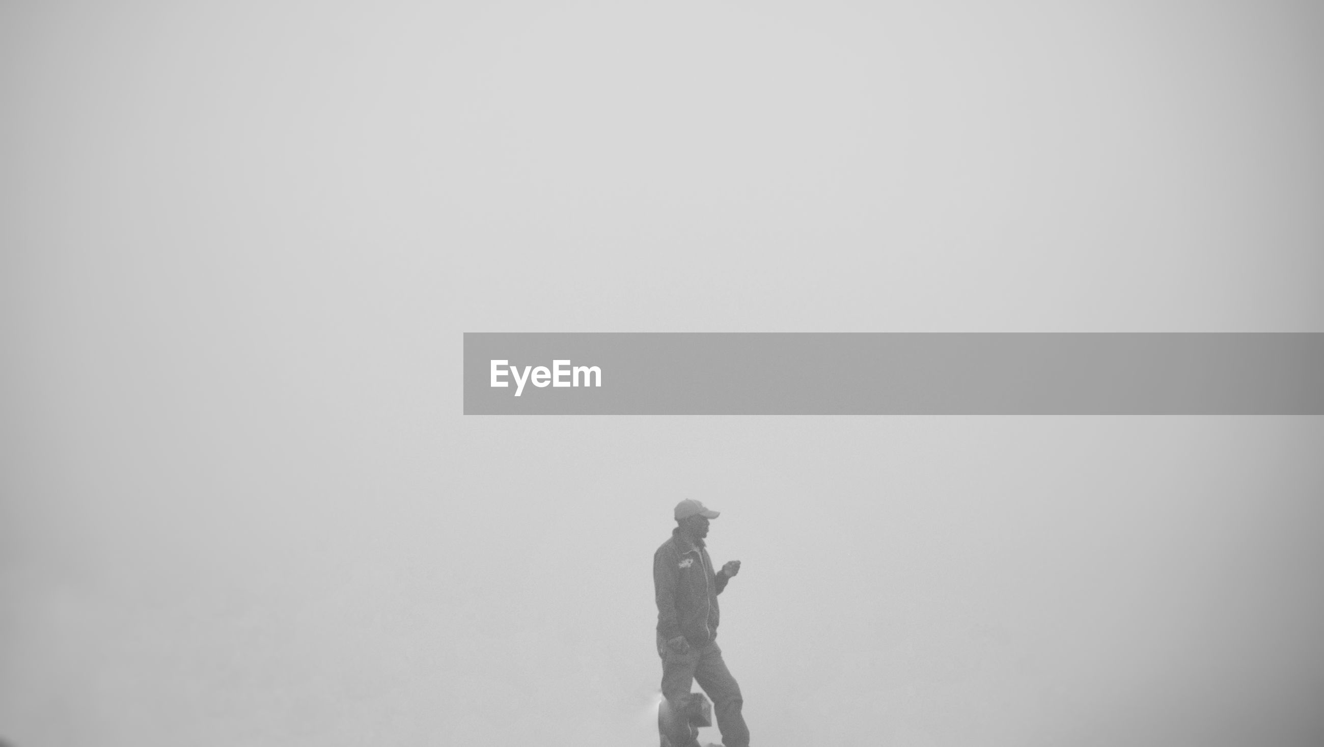 SIDE VIEW OF A WOMAN ON FOGGY DAY