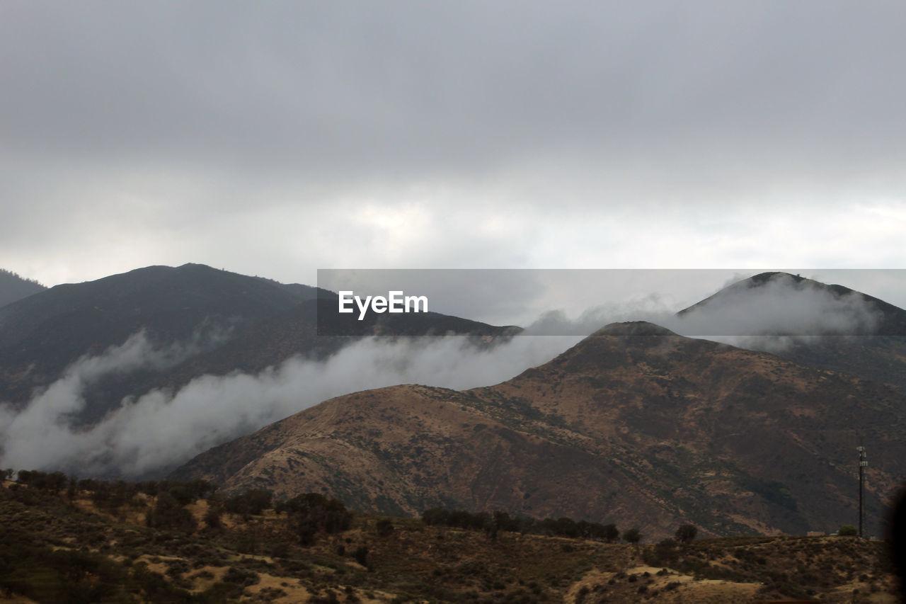 mountain, nature, beauty in nature, sky, landscape, peak, mountain range, outdoors, no people, scenery, day, range