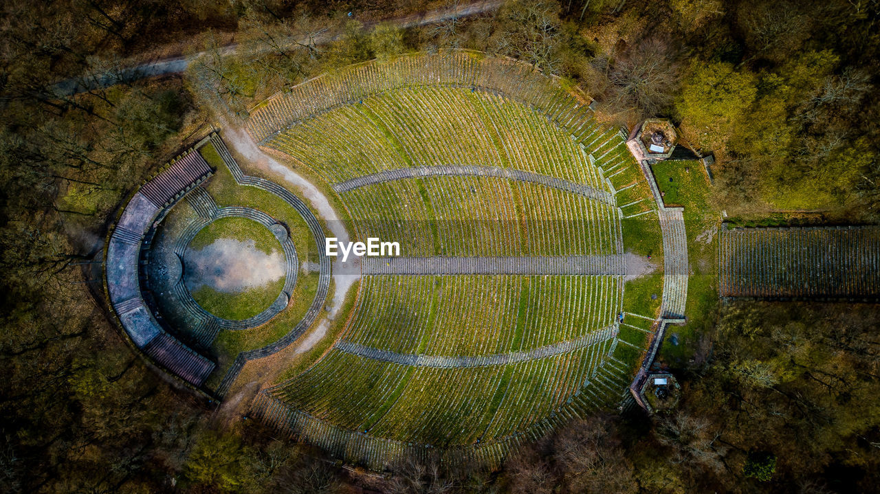 circle, shape, geometric shape, plant, day, nature, green color, high angle view, grass, architecture, aerial view, outdoors, landscape, no people, directly above, built structure, moss, environment, pattern, sport, digital composite, concentric