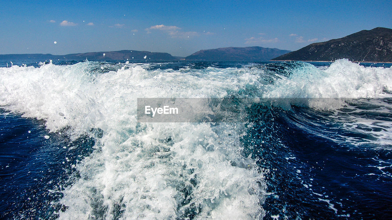 motion, beauty in nature, sea, water, nature, waterfront, wave, splashing, scenics, blue, no people, outdoors, mountain, day, sky, power in nature