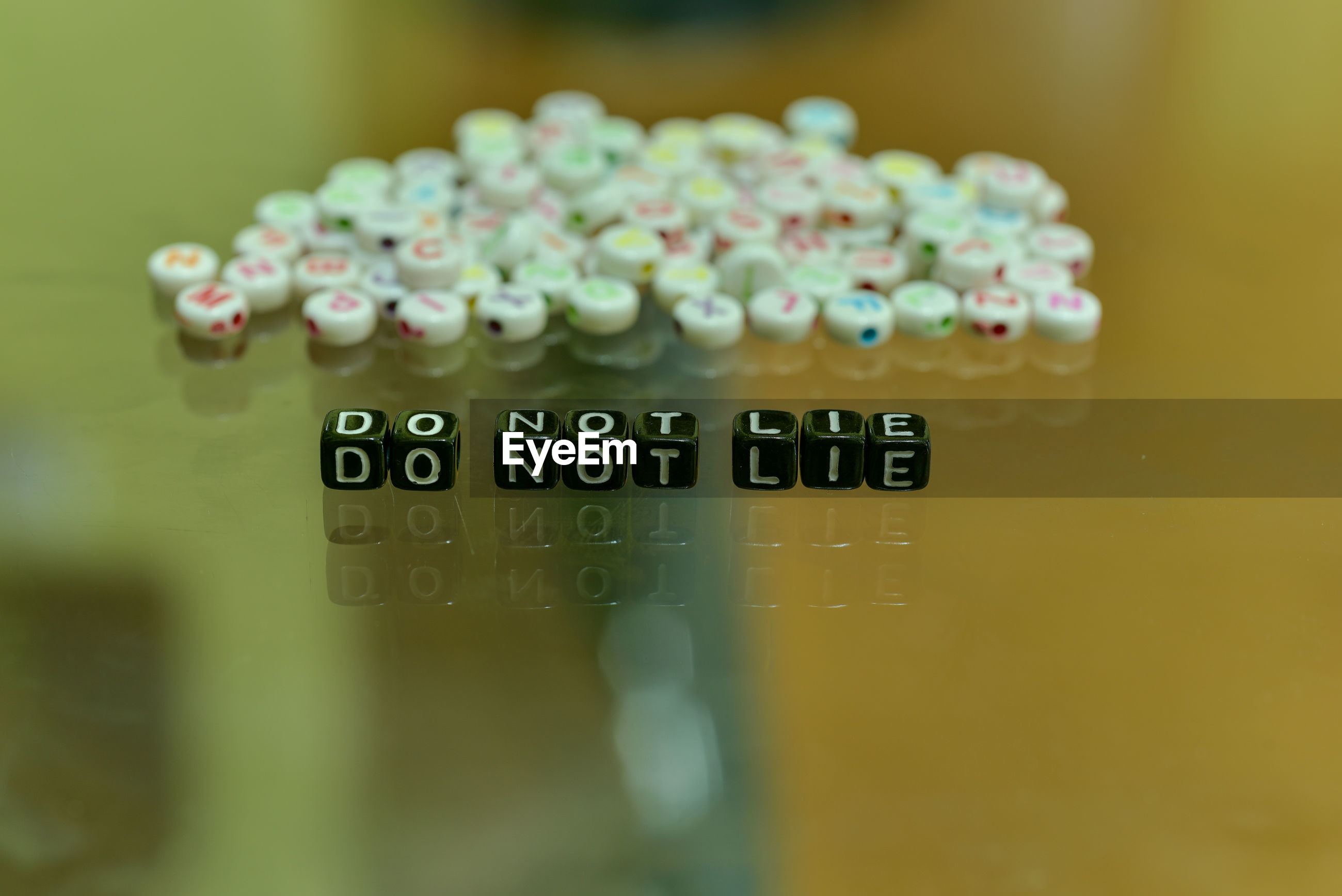 Close-up of toy blocks with text on table