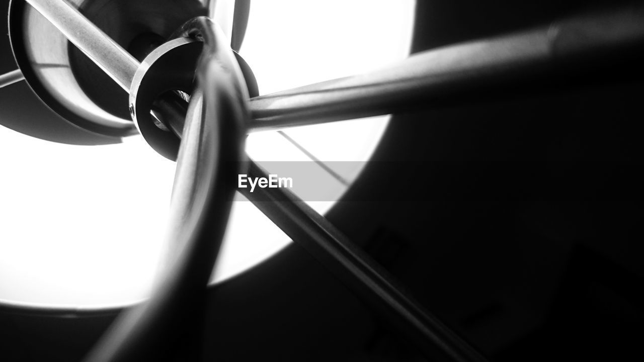 close-up, no people, metal, indoors, selective focus, day, shadow, focus on foreground, window, sunlight, security, detail, strength, protection, transportation, safety, railing, low angle view, copy space, wheel