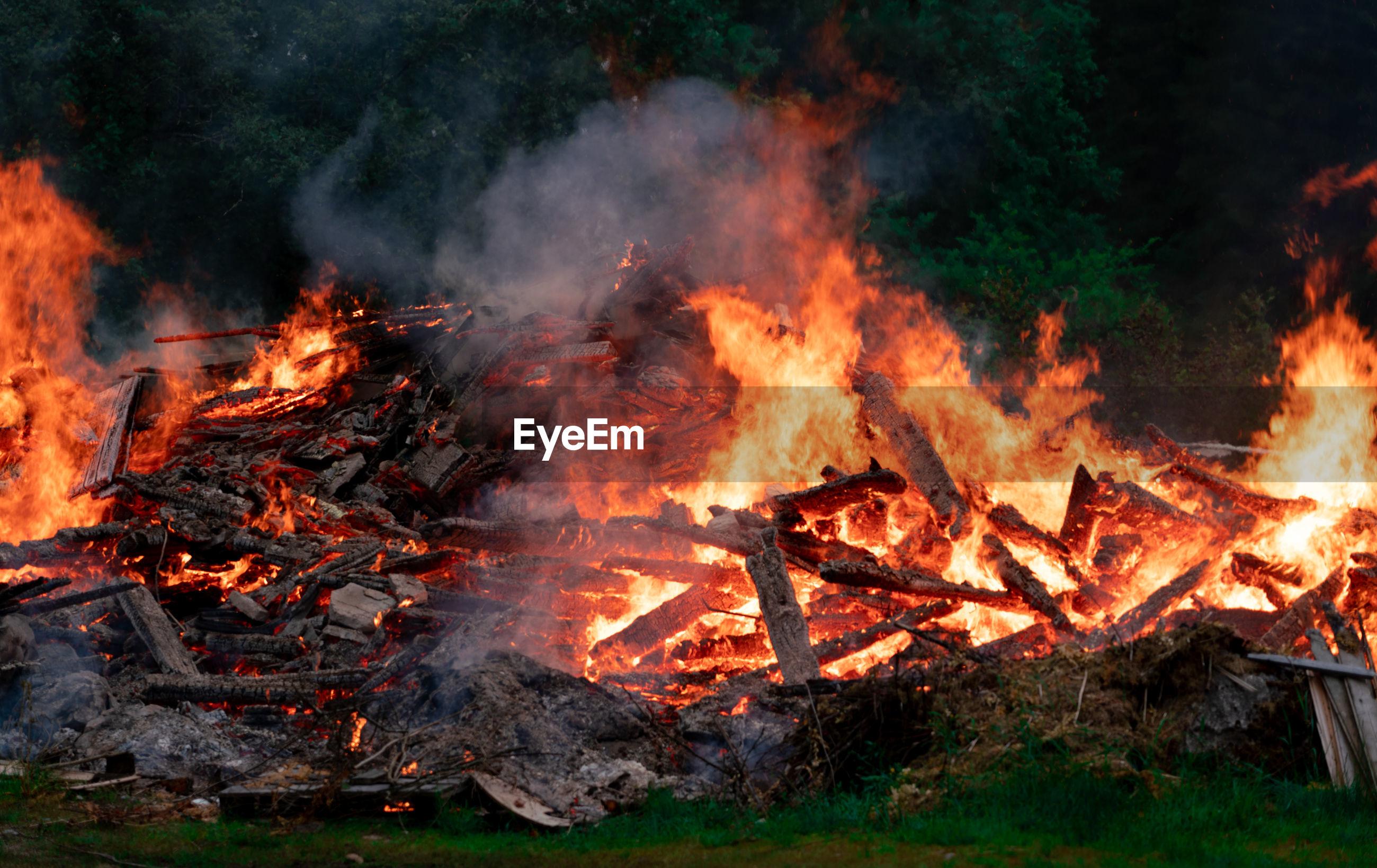 BONFIRE ON FIRE IN SUNLIGHT