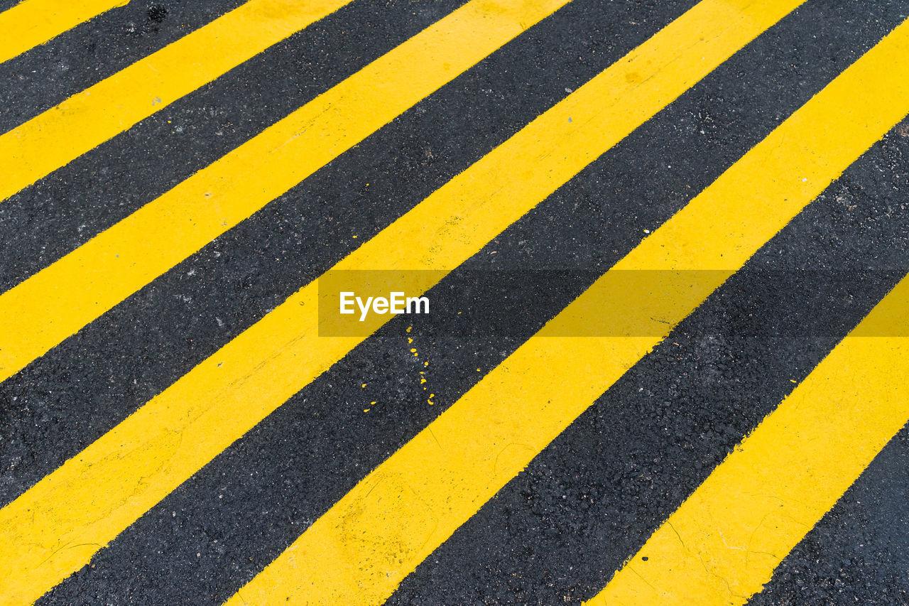 Close-Up Of Yellow Zebra Crossing