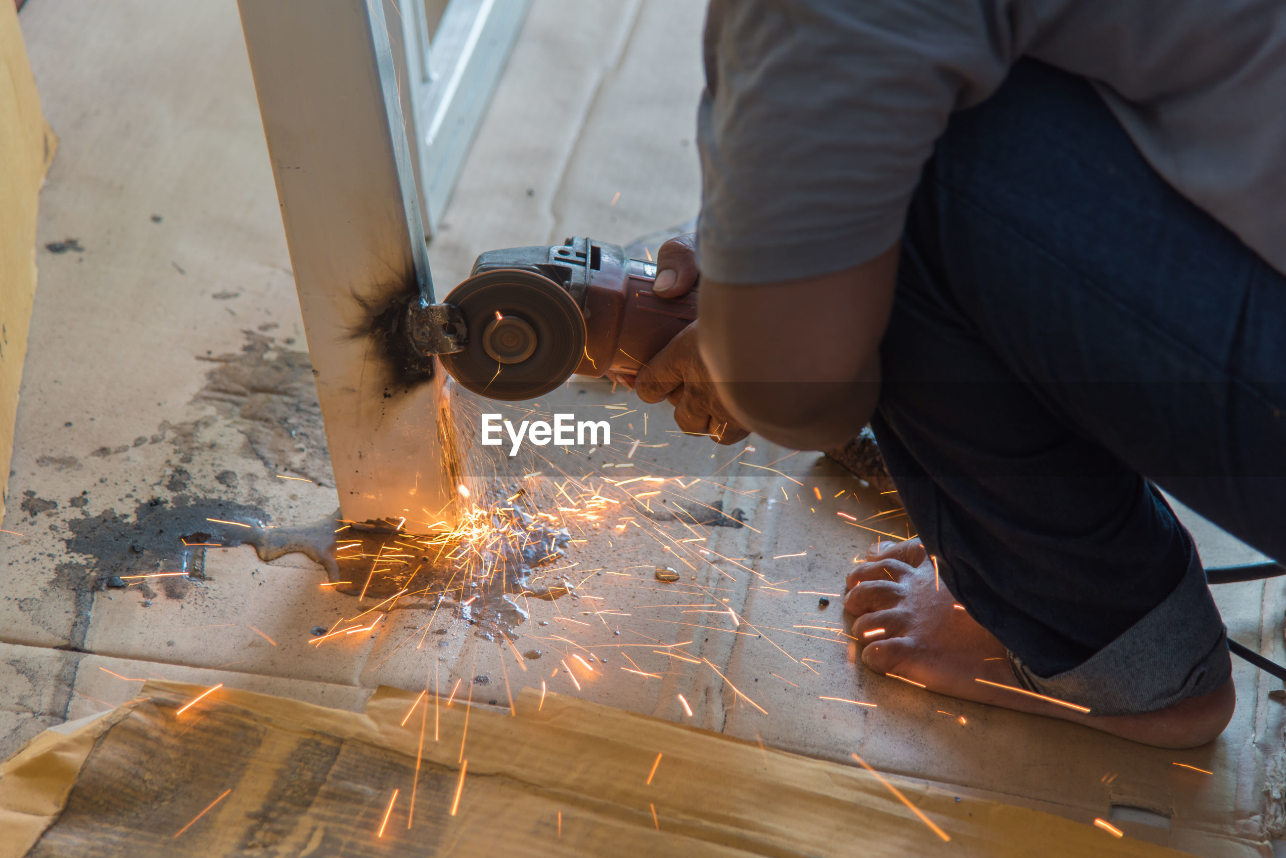 Close-up of person working on metal