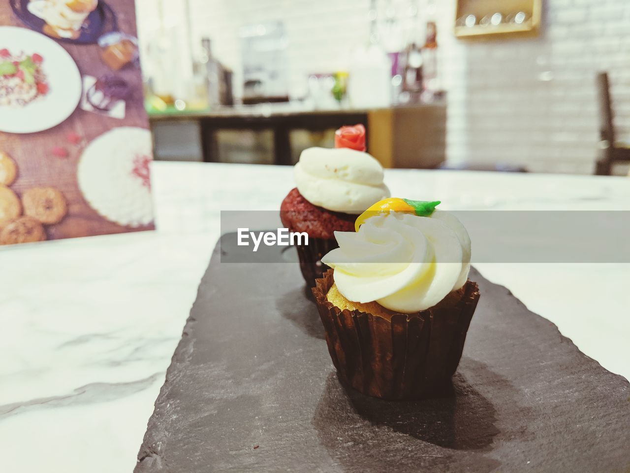 CLOSE-UP OF CUPCAKES WITH ICE CREAM