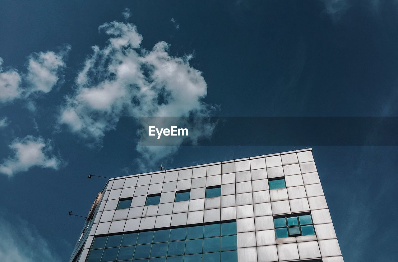 built structure, sky, cloud - sky, architecture, low angle view, building exterior, building, nature, no people, blue, outdoors, day, window, city, modern, flying, bird, industry, office building exterior, office, height